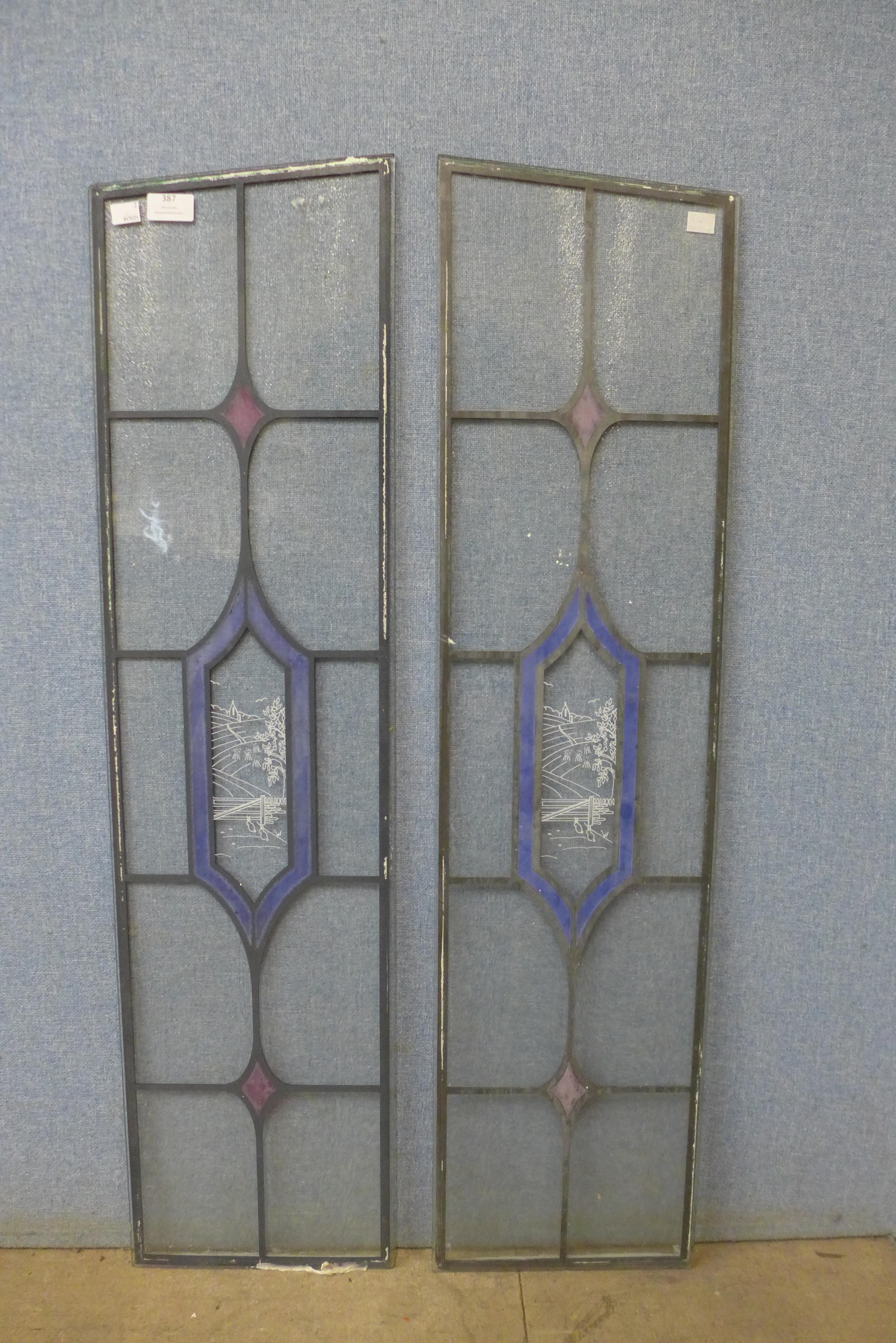 Two coloured glass window panes