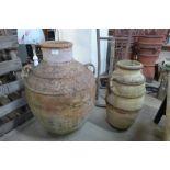 Two Italian Romanesque terracotta olive jars
