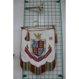 An armorial crest tapestry wall hanging