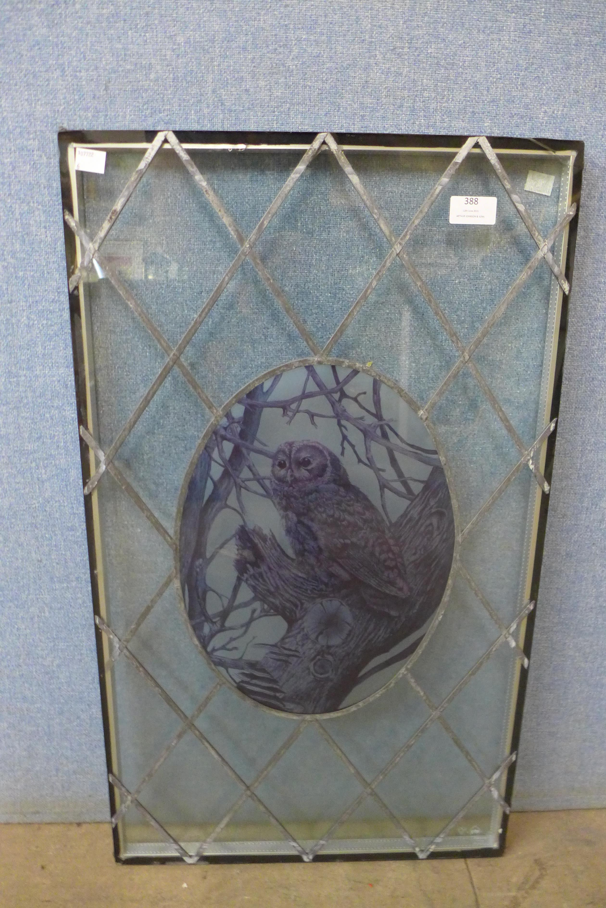A leaded glass panel with owl motif