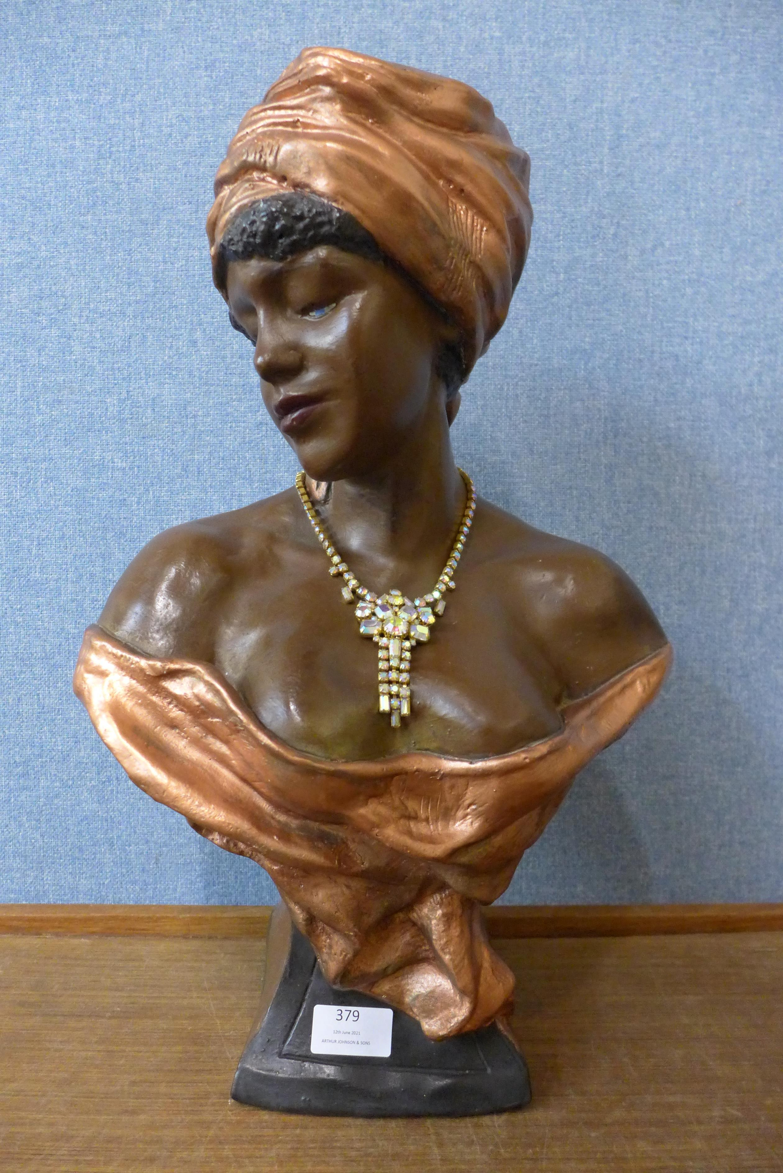 A plaster bust of a Caribbean lady