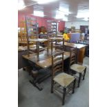 An oak extending refectory table and four ladderback chairs