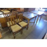 An oak barley twist draw-leaf table, four chairs and another drawer leaf table