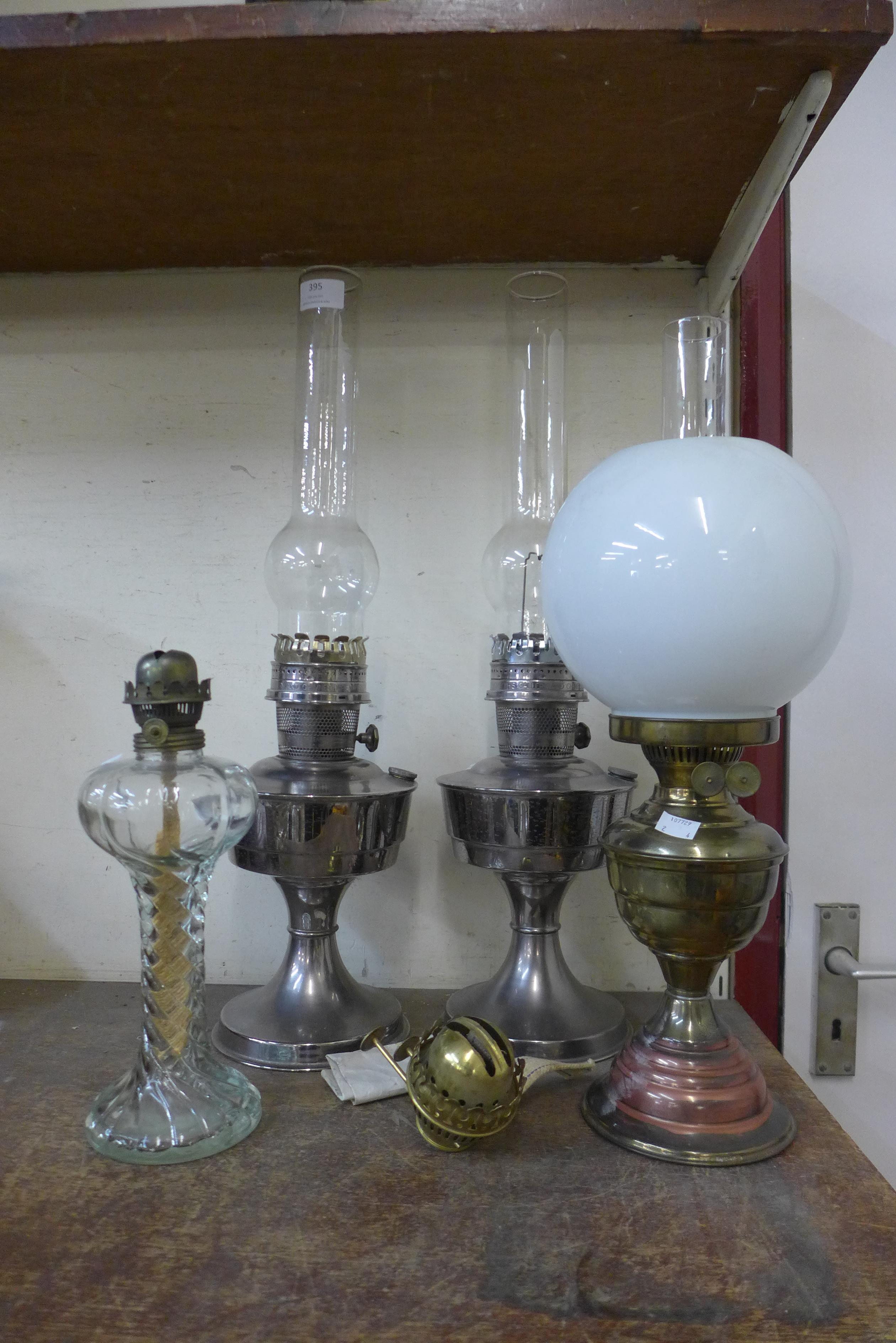 Four assorted oil lamps