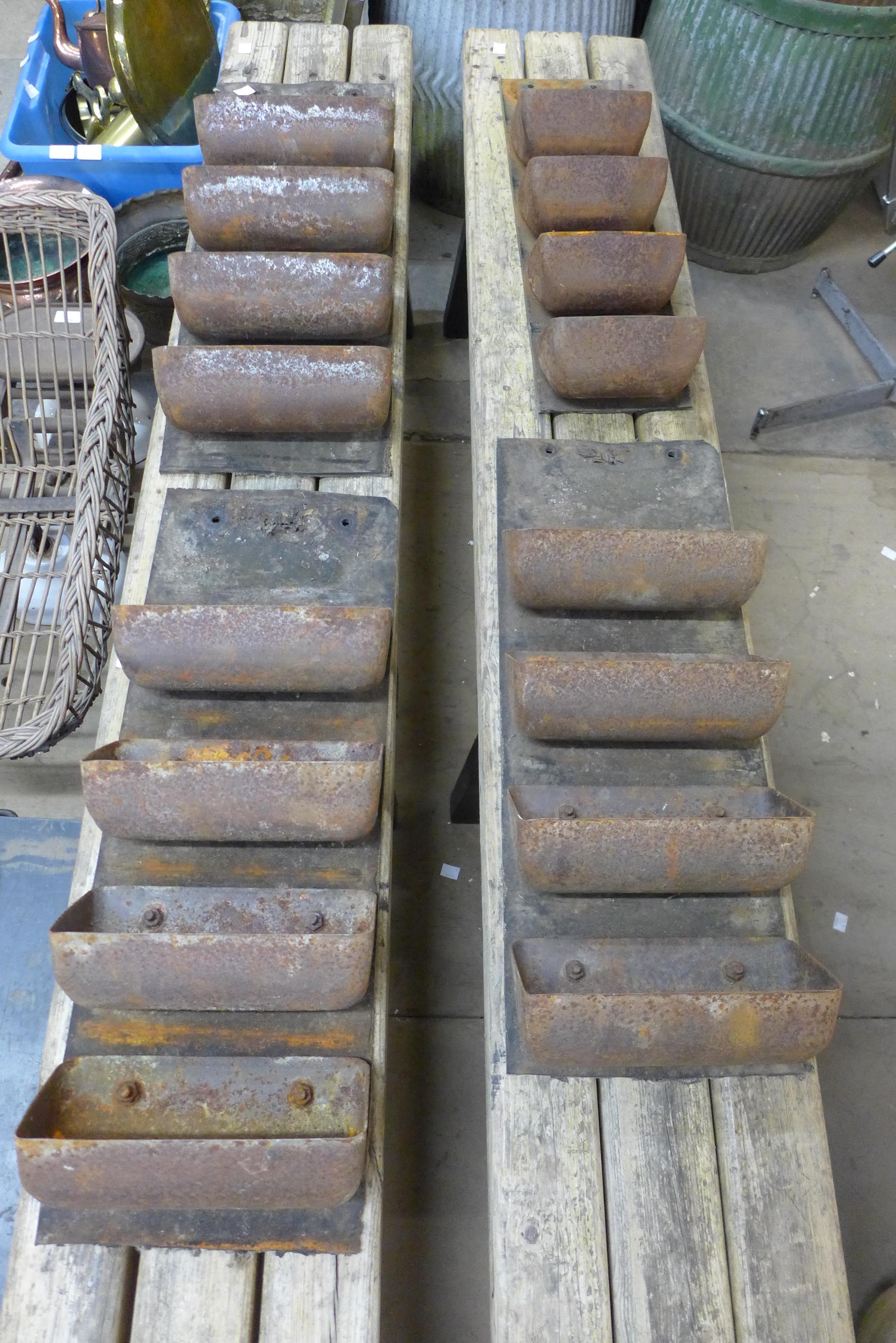 Four cast iron grain belts