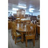 A carved oak barleytwist ten piece dining suite, comprising extending table, eight chairs and buffet