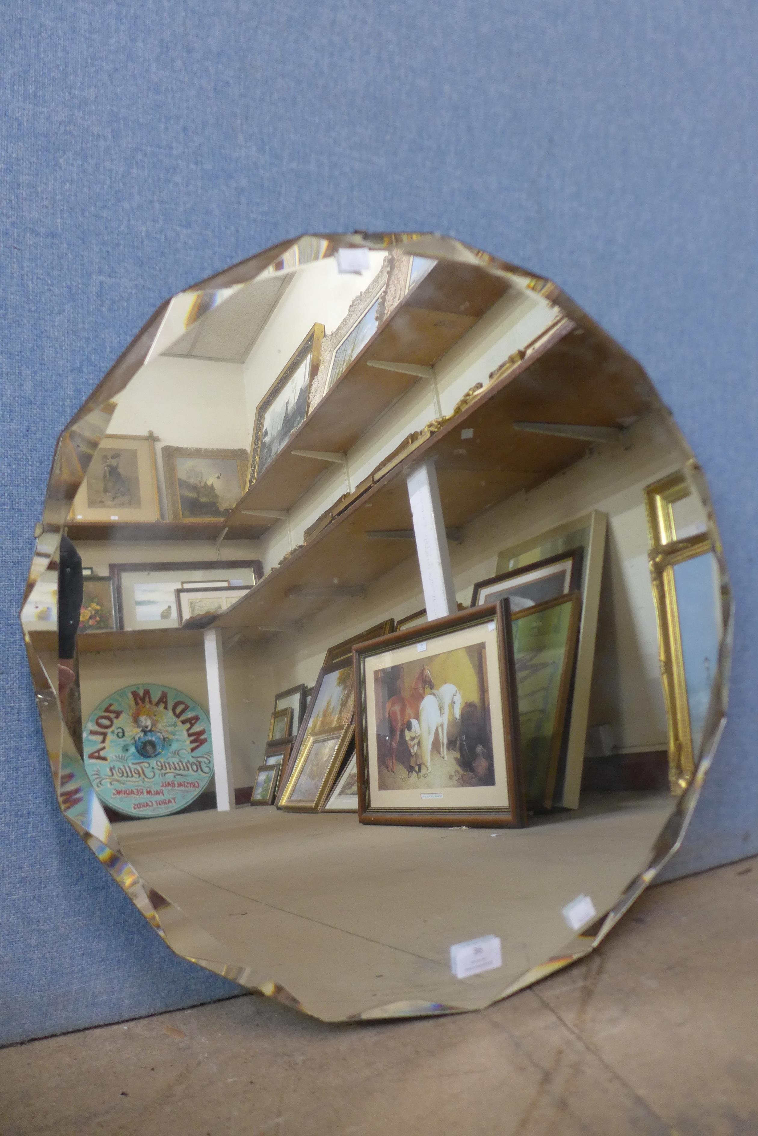 A circular beveled edge mirror