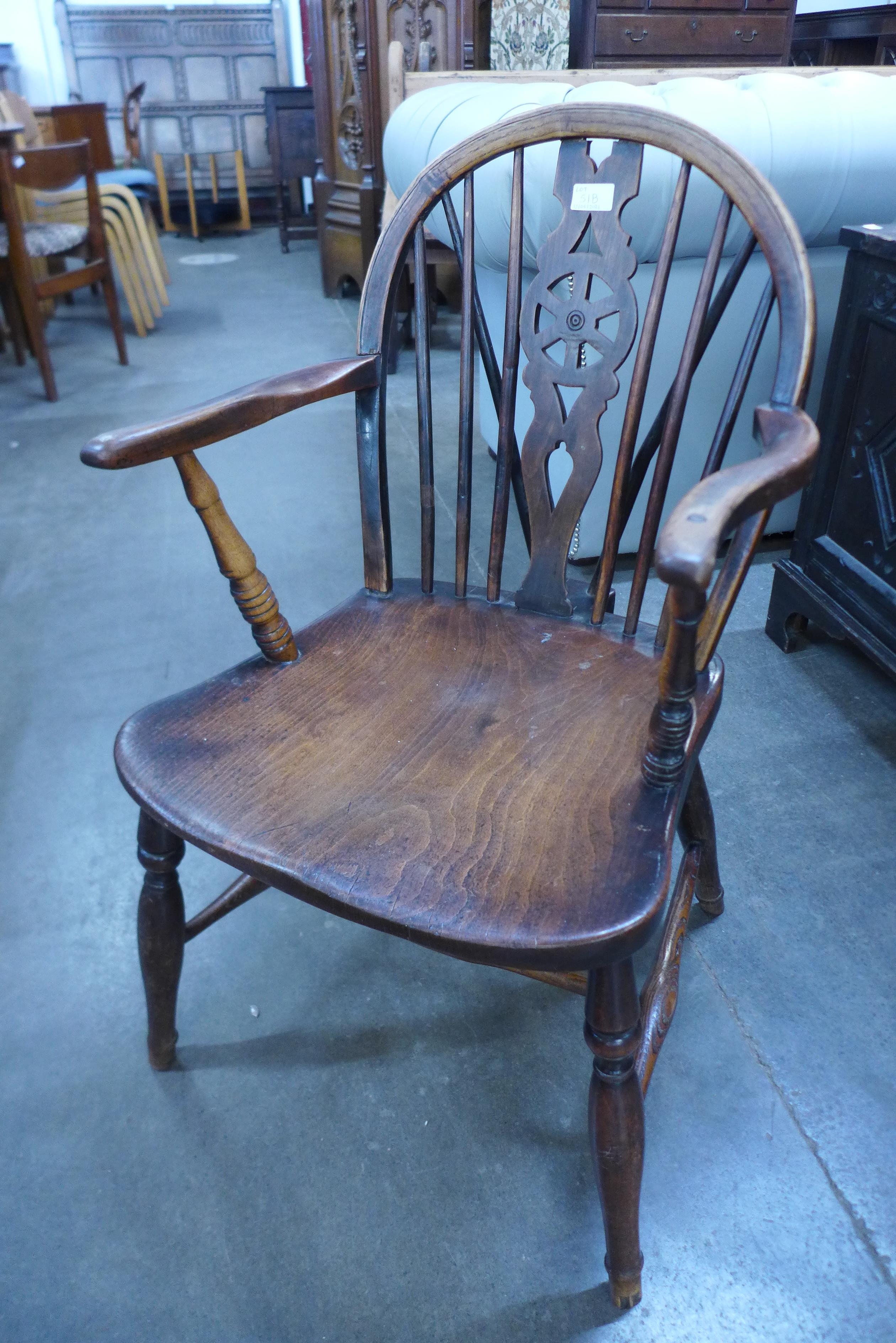 A 19th Century elm and yew wood wheelback Windsor chair