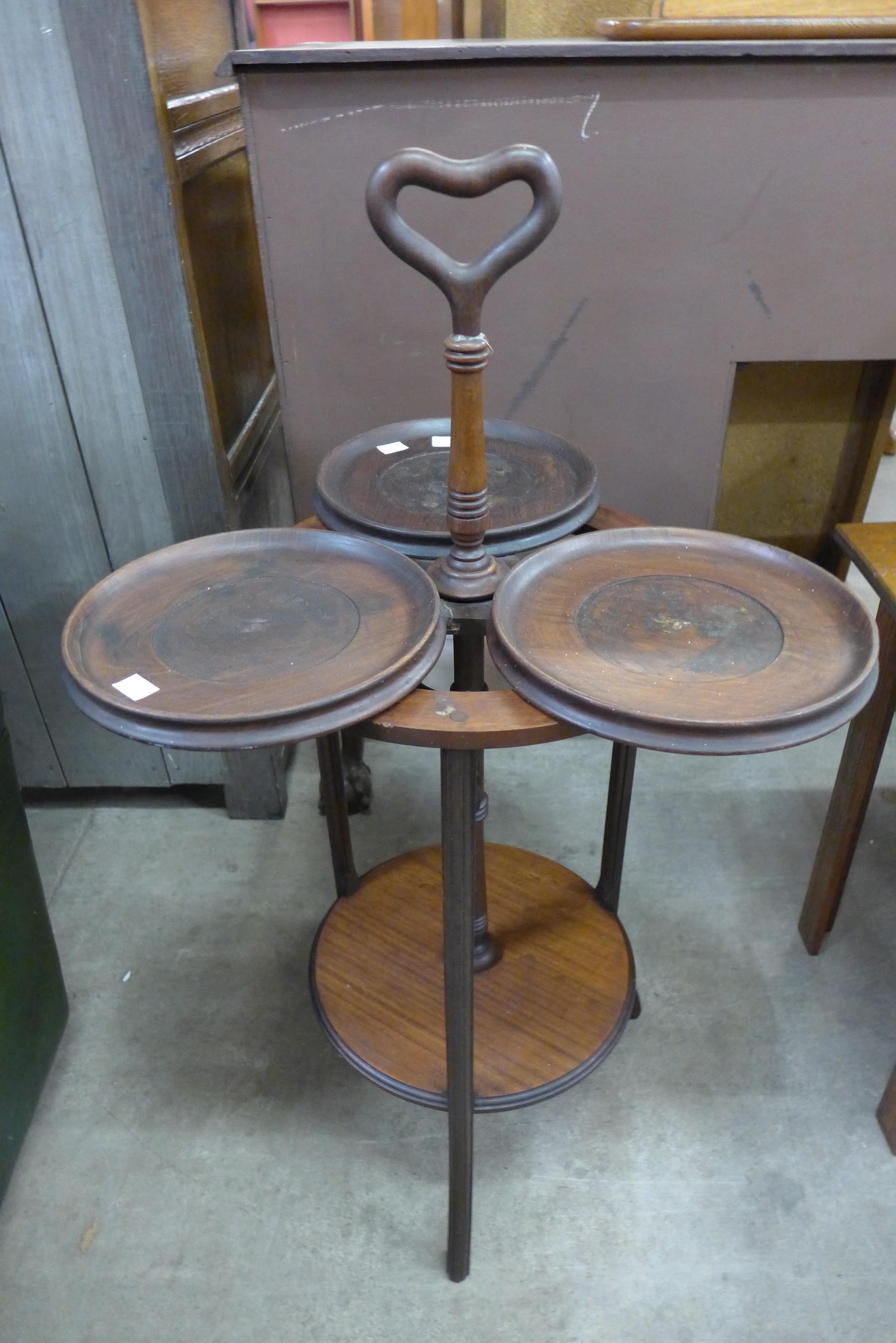 A revolving mahogany cake stand