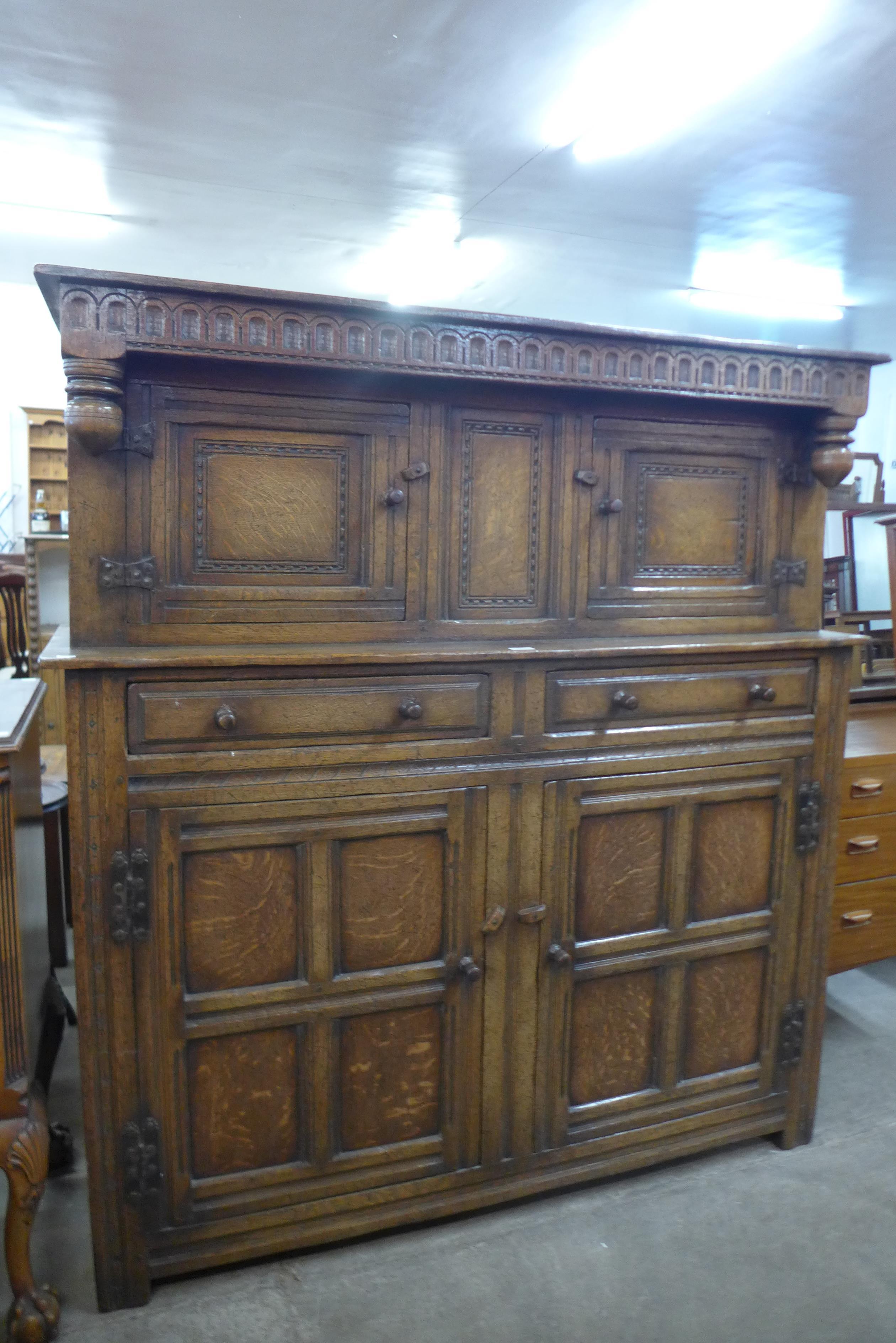 A carved Ipswich oak court cupboard