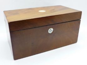 A Georgian walnut tea caddy with mother of pearl inlay (one inlay replaced with button)