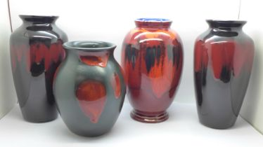 A pair of Poole vases, 21cm and two other Poole vases