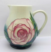 A Moorcroft Rose jug, for members of the Moorcroft Collectors Club, designed by Sally Tuffin, 14.5cm