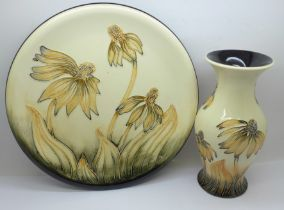 A Moorcroft Cone Flower plate, 26cm (crazed to centre) and vase, 19.5cm