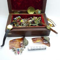 A brass inlaid jewellery box with costume jewellery, lady's wristwatches and spoons