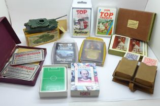 Four Top Trumps card games, other playing cards including footballers and an Airfix model