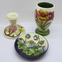 Three pieces of Moorcroft; small vase, dwarf candlestick and small dish