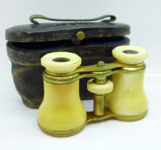 A pair of ivory opera glasses, cased, a/f