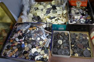 A tin and three boxes of vintage buttons and a tray of cream buttons