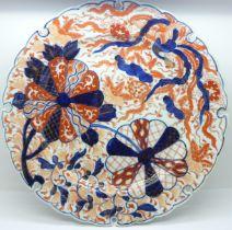 A large Imari dish, rim restored, 31cm