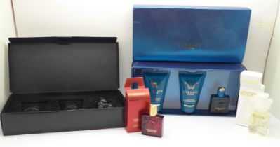 A Versace Eros and Moschino Toy Boy bathroom sets and two small eau de parfums, Versace and Moschino