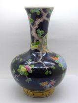A Chinese famille noir vase, 25cm