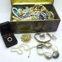 A tin of costume jewellery