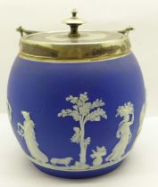 A Wedgwood Jasperware biscuit barrel with inscription on the underside of the lid dated 1881