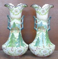 A pair of early 20th Century continental vases decorated in enamel, 30.5cm
