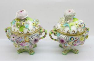 A pair of continental florally encrusted lidded pots, 14cm, some petals a/f