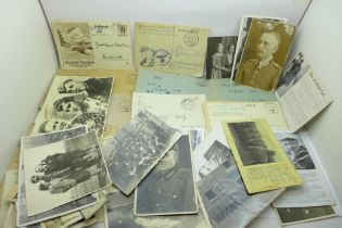 Twenty-six WWII German photographs and twenty-five postcards, six letters and two Osterkommunion
