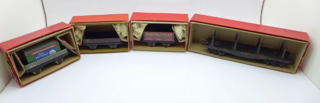 Four items of Trix Twin railway, three wagons and a Bogie Bolster, boxed