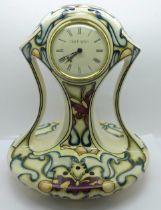 A Moorcroft Black Ryden tube lined clock, 25cm