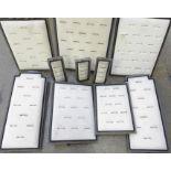 Ten vintage shop display ring pads in plated frames