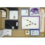 A collection of silver, amethyst and purple stone jewellery