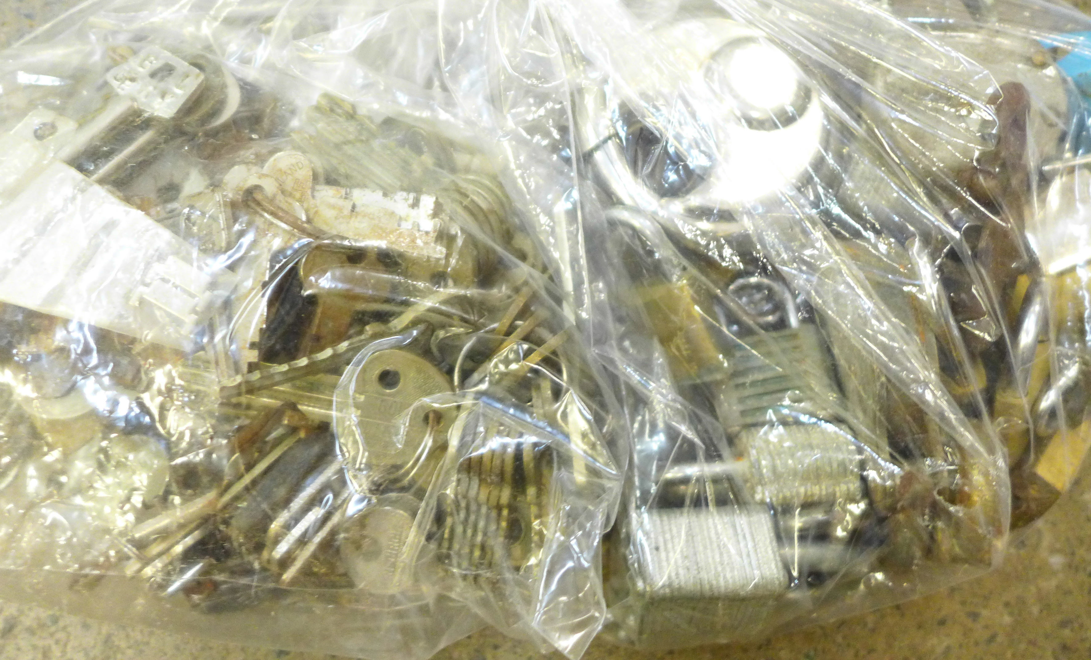 A collection of vintage padlocks and keys