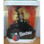 A Barbie doll, Happy Holidays, complete with box, 1991