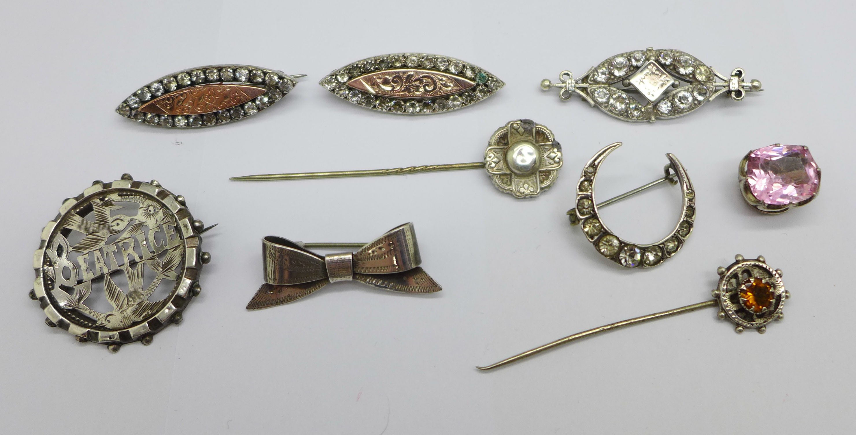 Two hallmarked Victorian silver and gilt fronted brooches, four other brooches, two stick pins and a