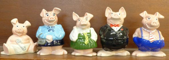 A set of five Nat West pig money banks, three lacking stoppers