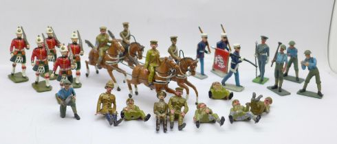 A collection of metal model military figures