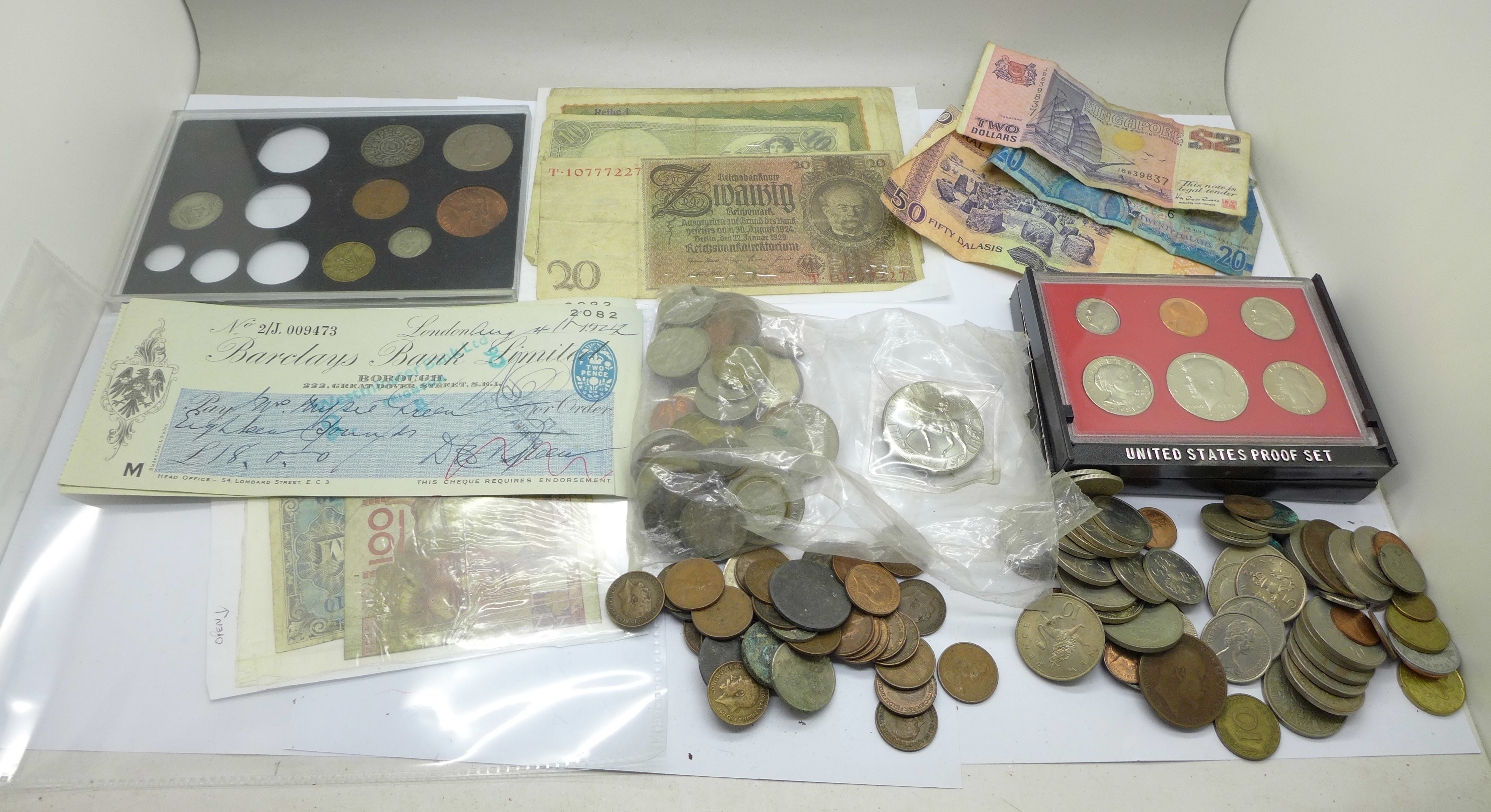 A tin of coins, bank notes and cheques