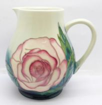 A Moorcroft Collectors Club rose jug, designed by Sally Tuffin, 14.5cm