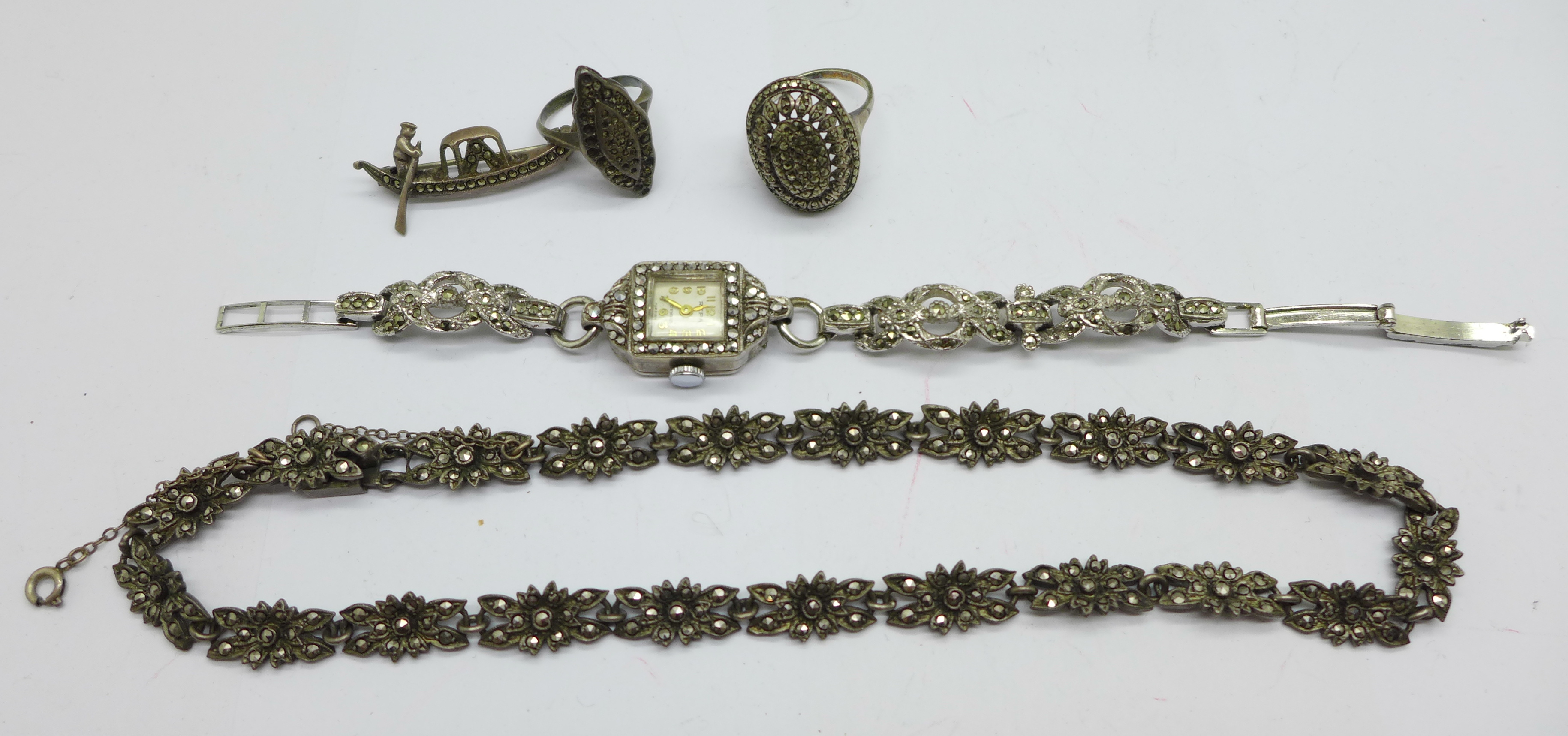 A collection of silver and marcasite jewellery including a lady's wristwatch