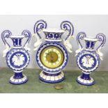 A ceramic clock garniture