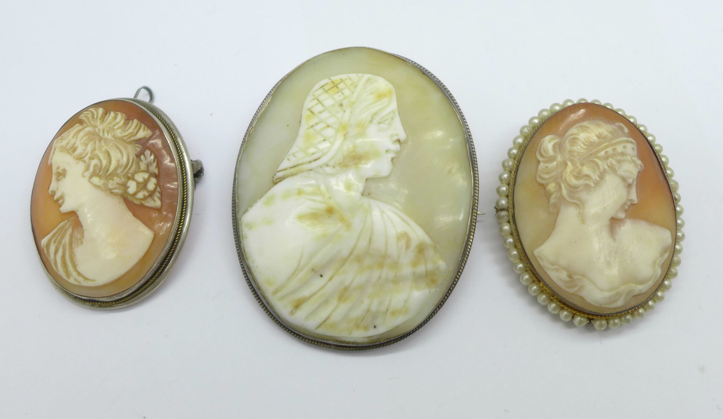 Three silver cameo brooches