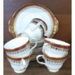 A six setting Duchess Winchester tea service with sandwich plate, gilding worn