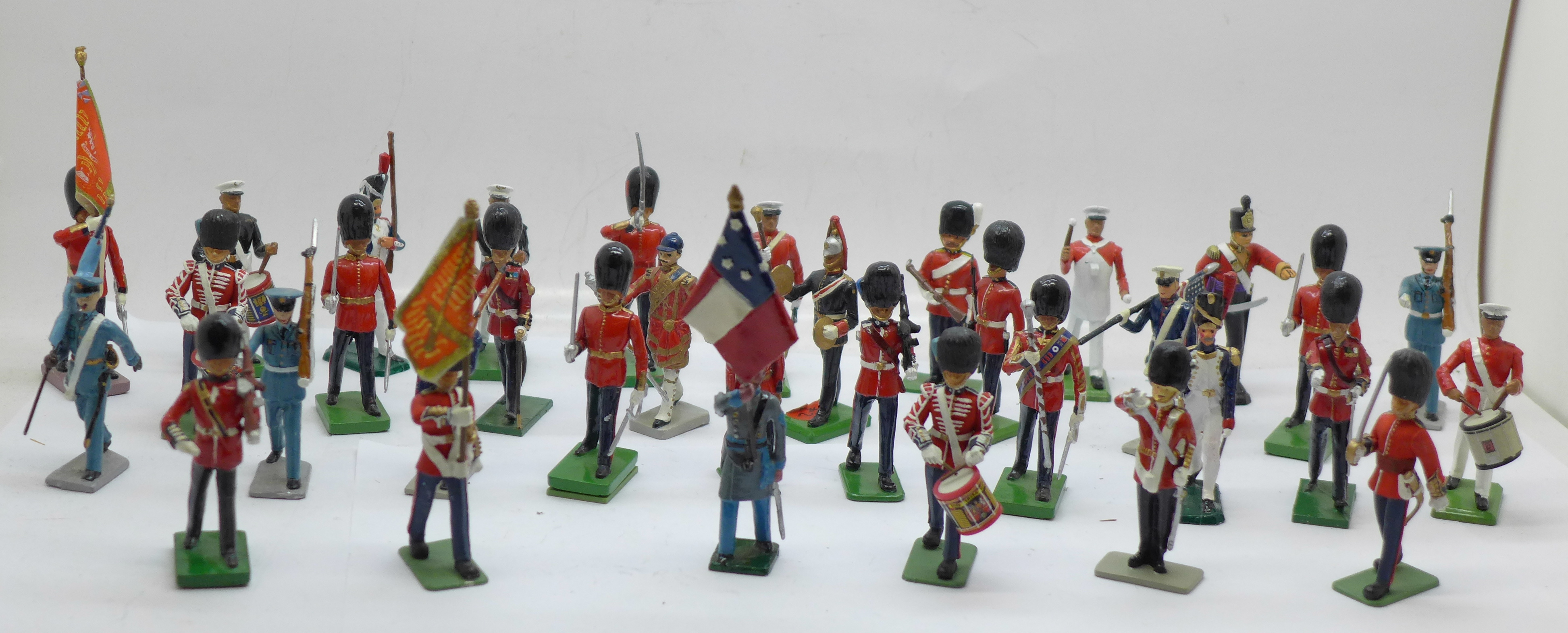 A collection of assorted metal military themed figures