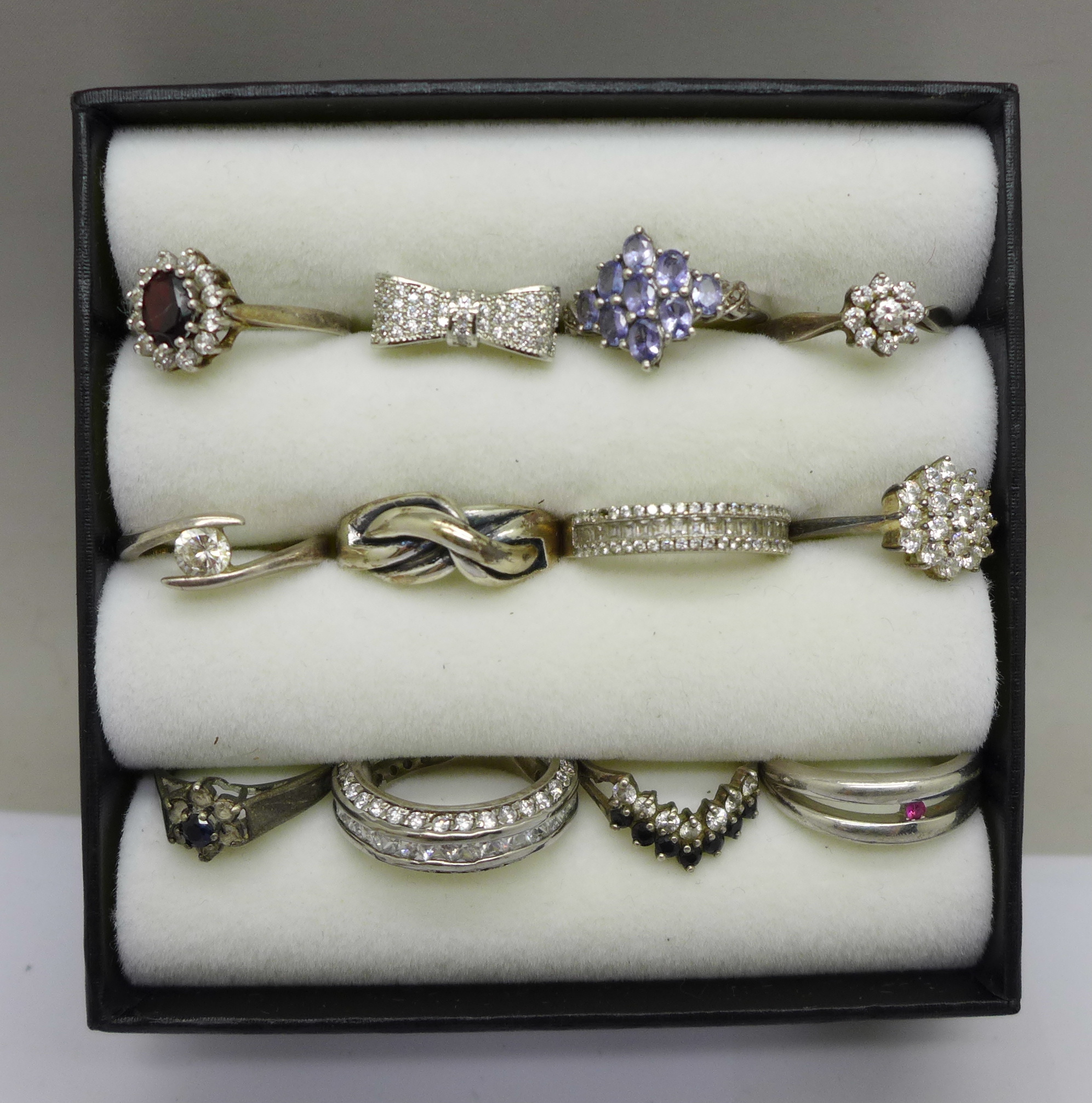 Twelve silver dress rings, most set with stones