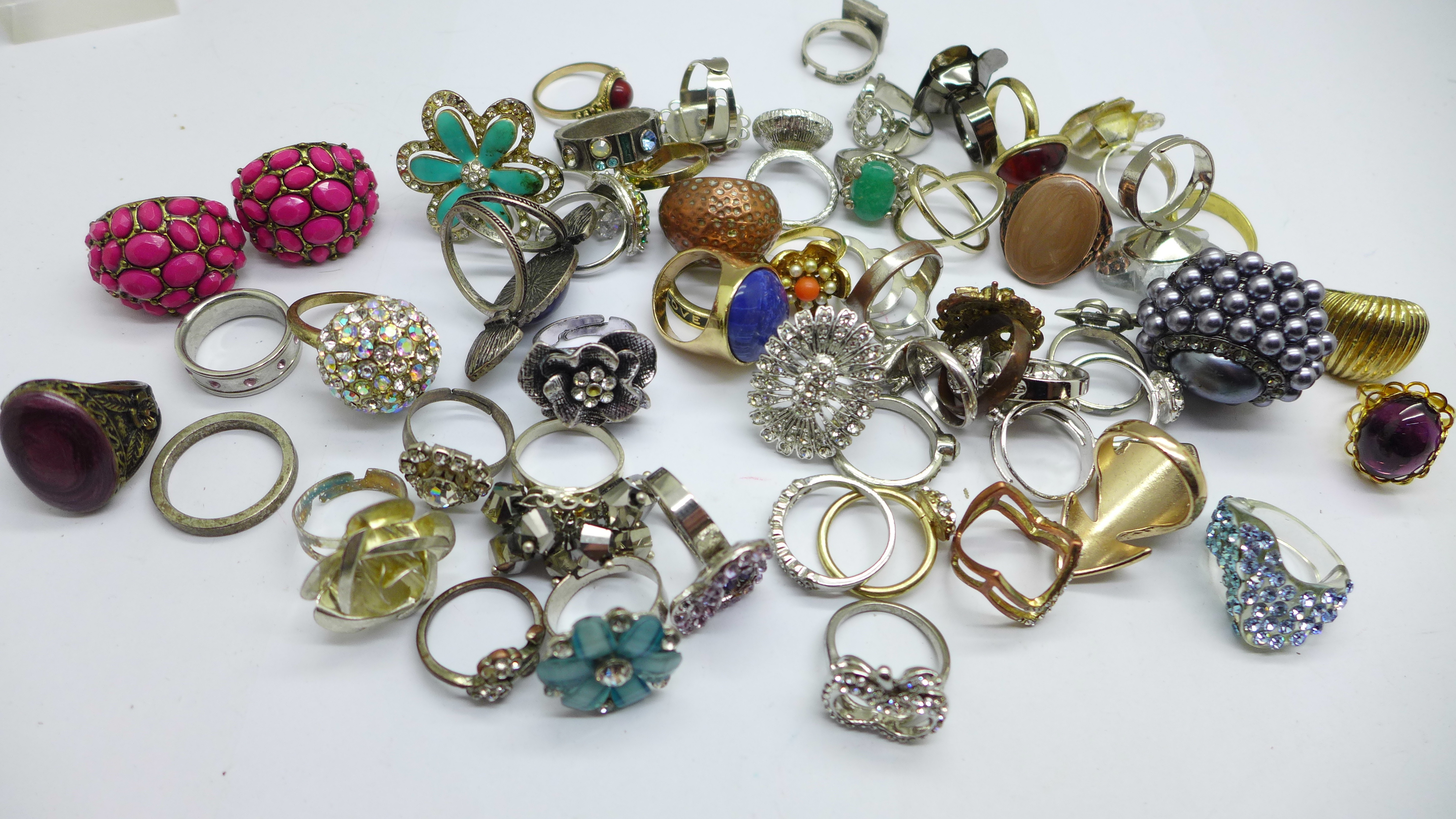Fifty-five costume rings