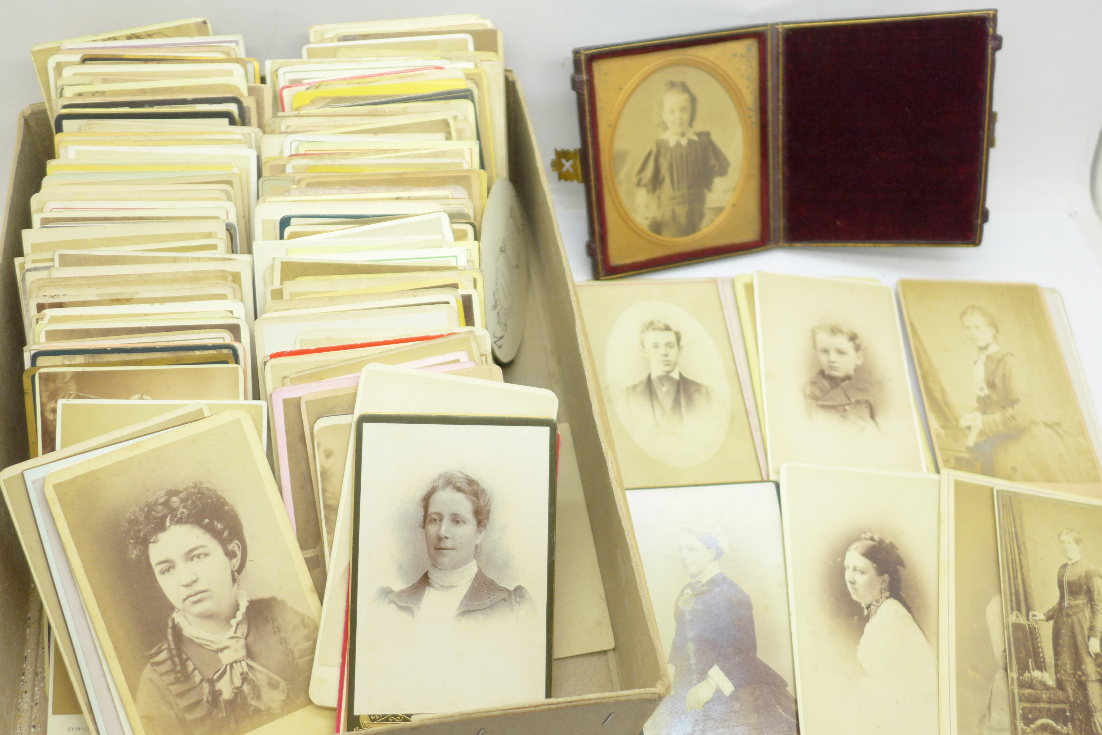 A box of over 200 Victorian carte de visite and a photograph in case